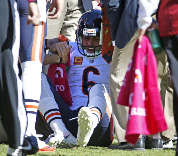 Bears quarterback Jay Cutler is injured after he is sacked by the Washington Redskins defense in the second quarter at FedEx Field.