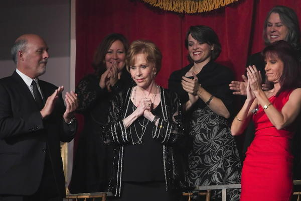 Comedian and actress Carol Burnett (C) is applauded by her husband Brian Miller (L) and members of her private box as she arrives to be feted during the presentation of the 2013 Mark Twain Prize for American Humor at the Kennedy Center in Washington.