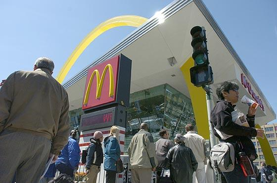 Customers wait in line to enter the new McDonald's on Clark and Ontario on Friday.