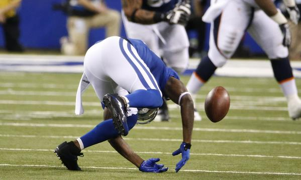 Indianapolis receiver Reggie Wayne goes down with a right knee injury during Sunday night's game against Denver.