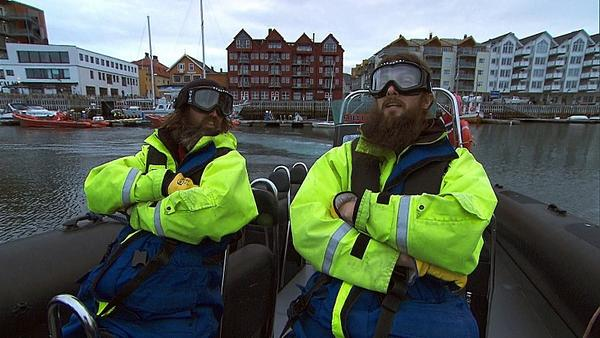 "Childhood friends Adam (left) and Brandon (right) travel by high speed boat to the fishing village of Henningsvaer, Norway on ""The Amazing Race."""