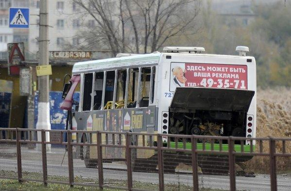 Authorities examine a bus damaged by an explosion in Volgograd, Russia. Officials said the blast was set off by a suicide bomber.