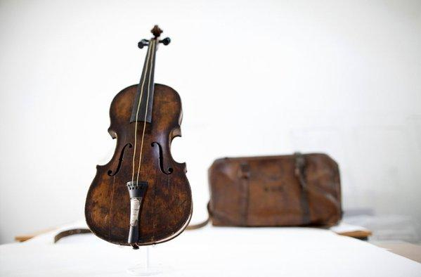 The violin played by bandmaster Wallace Hartley during the final moments before the sinking of the Titanic is shown, along with a leather carrying case initialed WHH.