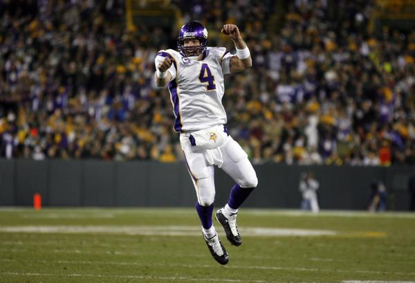 Brett Favre celebrates his fourth touchdown pass during the Minnesota Vikings' 38-26 victory over the Green Bay Packers at Lambeau Field in 2009.