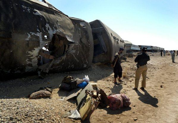 Pakistani security officials inspect a Jaffar Express train hit by a bomb blast near Nasirabad district in the Baluchistan province of Pakistan on Monday.