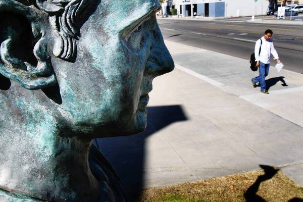A statue of Alex Odeh stands next to the rear entrance of Santa Ana Main Library. Odeh was a Palestinian American civil rights leader who was killed when a pipe bomb exploded in his office.