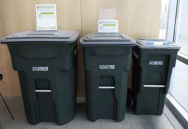 An example of wheeled trash receptacles on display at Newport Beach City Hall. These would be used in the automated trash pick-up service replacing manual service.