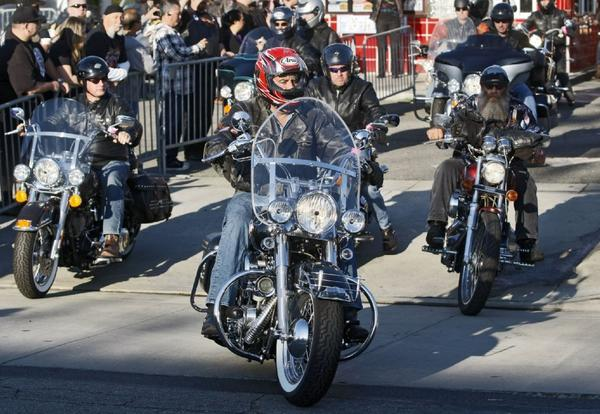 Comedian Jay Leno, center, leads the way from Harley-Davidson of Glendale in the 30th annual Love Ride.