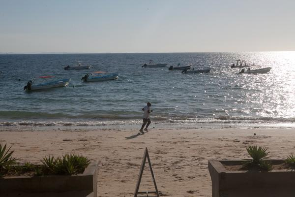 A tourist runs on the beach at Nosy Be in Madagascar.