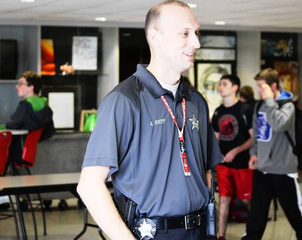 Anthony Kropp, Deefield High School's new school resource officer, talks with school staff in the commons area.