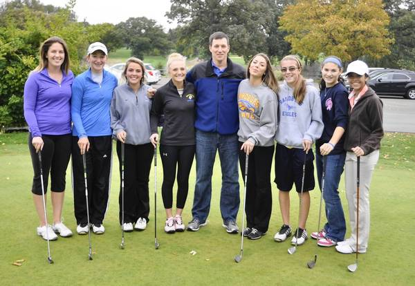 Sandburg's girls golf team poses before its final practice at Silver Lake Country Club before heading to Decatur to participate in the IHSA state meet for the first time in school history.