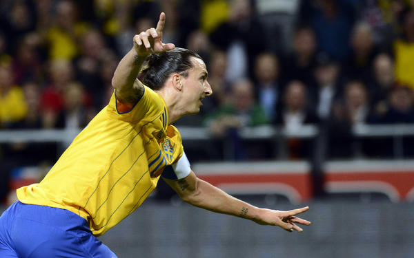 Sweden's striker and team captain Zlatan Ibrahimovic celebrates after scoring his 1st goal of the match during the FIFA World Cup 2014 friendly match England vs Sweden in Stockholm, Sweden on November 14, 2012.