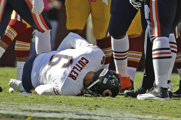 Chicago Bears quarterback Jay Cutler lies on the field after being injured in a sack by Washington Redskins defensive end Chris Baker on Sunday.