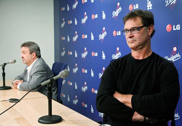 Dodgers General Manager Ned Colletti, left, and Manager Don Mattingly speak to the media Monday at Dodger Stadium.