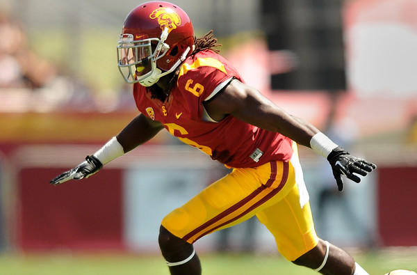 USC safety Josh Shaw celebrates his tackle of Boston College's David Dudeck during a game earlier this season.