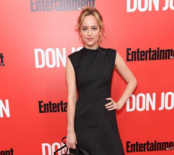 "Actress Dakota Johnson, said to be sticking with the ""Fifty Shades of Grey"" adaptation, is seen at the New York premiere of ""Don Jon."""