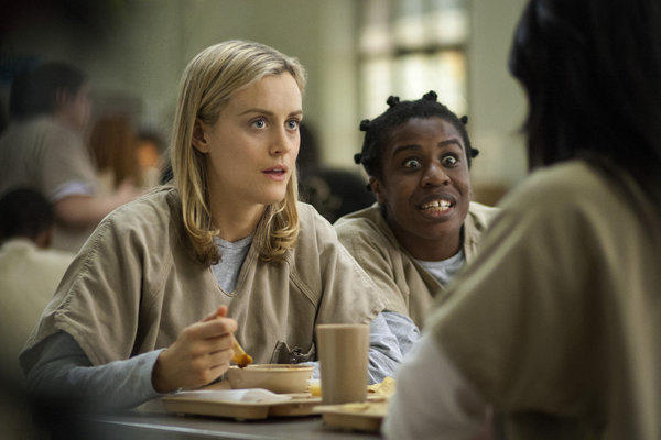 "Taylor Schilling, left, and Uzo Aduba star in the Netflix series ""Orange Is the New Black."""