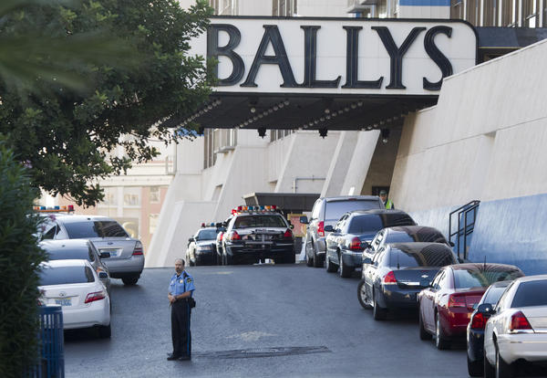 Las Vegas Metro Police cars and a hotel security officer are stationed in front of Bally's hotel casino after an early morning shooting left one person dead and two wounded at Drai's, a nightclub inside Bally's. A suspect is in custody, police said.