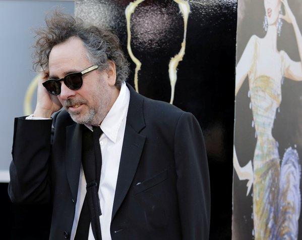 "Director Tim Burton is expected to return for a ""Beetlejuice"" sequel being written by Seth Grahame-Smith."