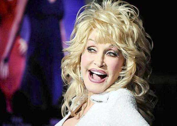 """Actress and singer Dolly Parton arrives at the Hollywood premiere of """"Joyful Noise"""" in Los Angeles, California."""