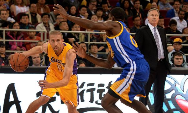 Lakers Coach Mike D'Antoni, right, watches guard Steve Blake, left, drive past Golden State's Tony Douglas during a preseason game in Beijing last week. D'Antoni appears to recognize that the Lakers lack the personnel to play at the ultra-fast pace for which his teams are known.
