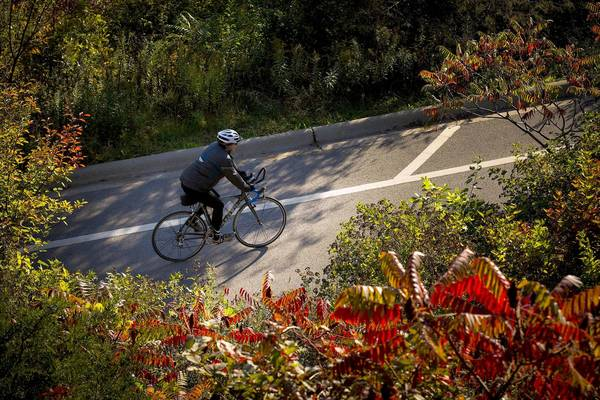 A bicyclist rides through Lakefront Park in Glencoe. One avid North Shore cyclist recommends zigzagging through the area on the small streets just west of Sheridan Road.