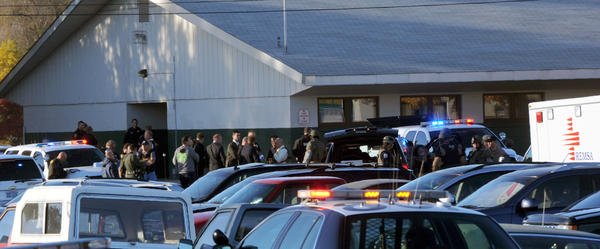Law enforcement personnel gather at the scene of a shooting at Sparks Middle School in Sparks, Nev.