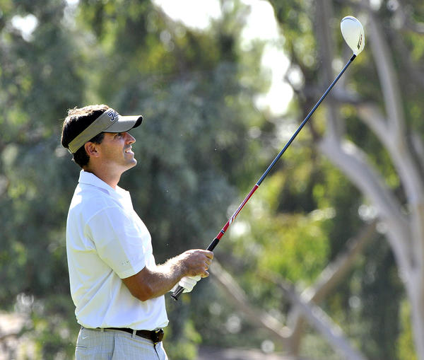 Palm Crest father Todd Reynolda, of La Canada, tees off on the second and watches his shot at La Canada Flintridge Country Club in La Canada Flintridge where the Palm Crest Elementary School PTA's Dad's Committee hosts a golf tournament on Monday, October 21, 2013.