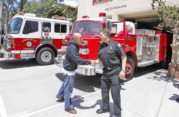 Dan Stefano, right, seen here with Carlos Frontela, left, is the new Costa Mesa fire chief.