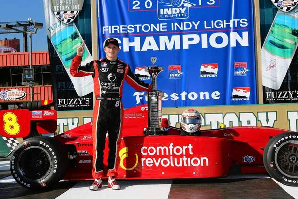 Nazareth High School senior Sage Karam stands next to the trophy after winning the Firestone Indy Lights championship in Fontana, Calif., last weekend.