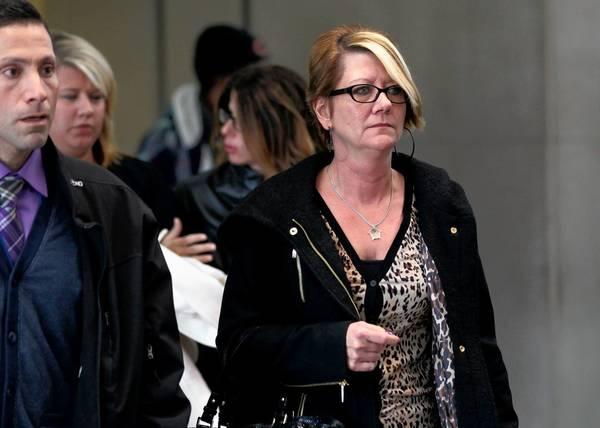 Deborah Francis, widow of slain Chicago police officer Richard Francis, leaves the Leighton Criminal Court Building for a lunch break during the trial.