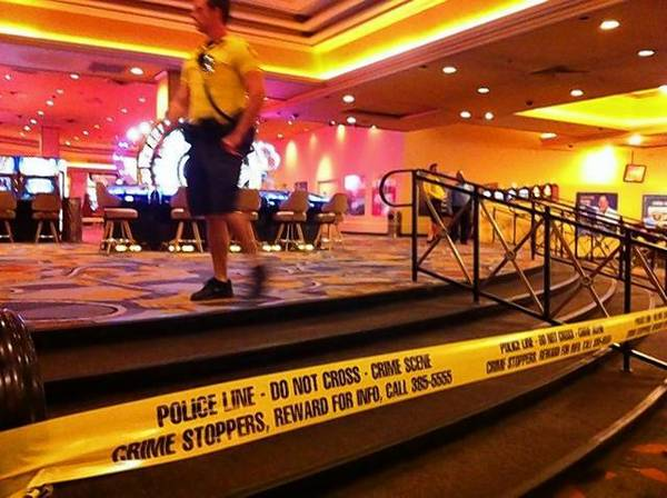 Security workers cordon off the scene of a shooting at Bally's casino in Las Vegas. One man was killed.