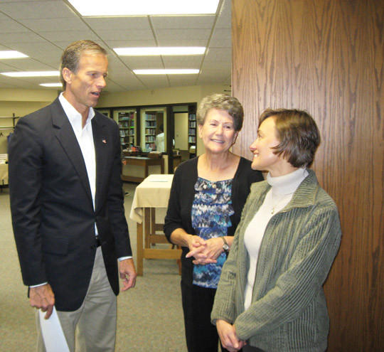 Sen. John Thune, R-S.D., speaks to Elaine Just, center, and Lynne Fuhrman before giving a talk at Aberdeen Christian School on Monday. Just is a school board member and former teacher at the school. Fuhrman teaches at the school.