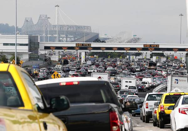 Traffic backs up on Interstate 80 in Oakland at the San Francisco-Oakland Bay Bridge as the Bay Area Rapid Transit strike snarls the Monday morning commute.