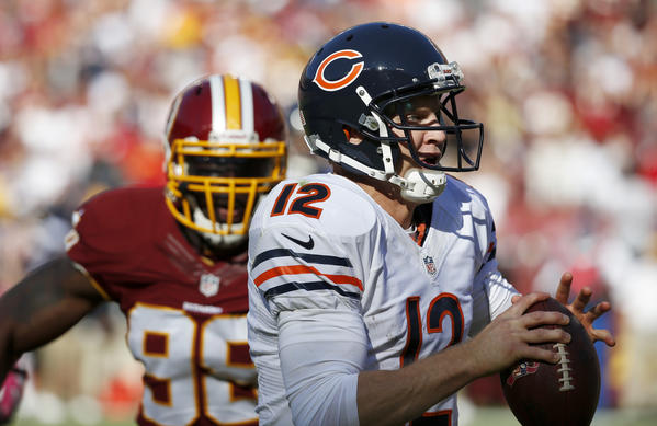Bears quarterback Josh McCown (12) runs away from the Washington Redskins pass rush in the third quarter.