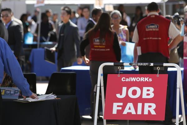 CalWORKs Job Fair signs are displayed during the Fall Classic Hiring Spree event at Los Angeles City College in Los Angeles.