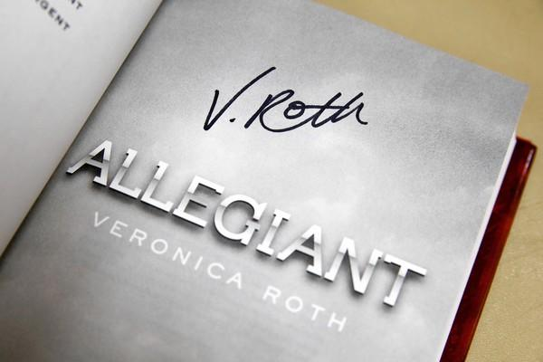 """Young adult author Veronica Roth signs over 3,000 books at the Anderson and Sons warehouse, including her newest, """"Allegiant,"""" to be released next week."""