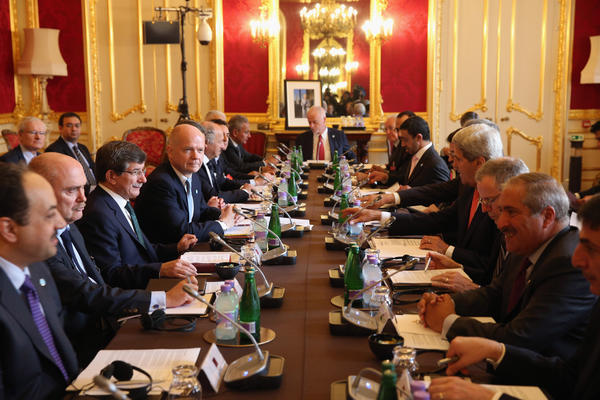 "U.S. Secretary of State John Kerry, fourth from right, attends a meeting in London on Tuesday hosted by British Foreign Secretary William Hague, fourth from left. The meeting at Lancaster House was of the ""London 11,"" from the Friends of Syria Core Group, aimed at ending the civil war in Syria."