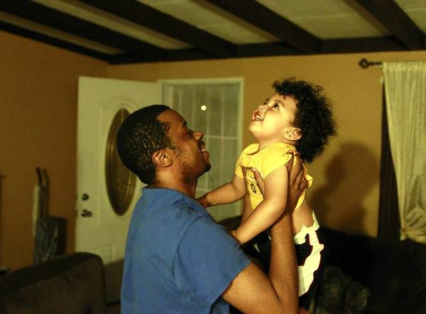 Micheal Williams, 30, plays with his son Maceo Williams, 2, at his home in Rowland Heights. Williams is avoiding a federal felony conviction and prison time by participating in the alternative sentencing program CASA.