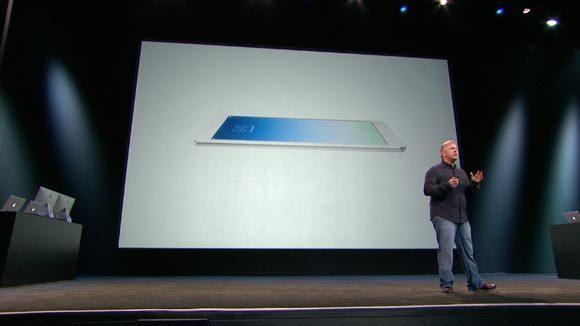 Apple executive Phil Schiller shows off Apple's new iPad Air, the fifth-generation iPad, Tuesday in San Francisco.