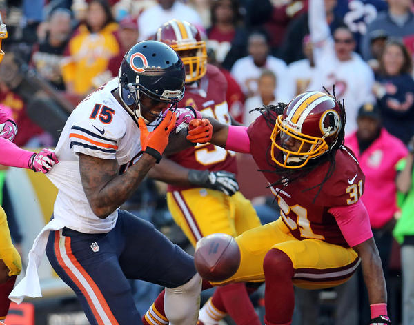 Bears wide receiver Brandon Marshall takes a hit from Redskins strong safety Brandon Meriweather.