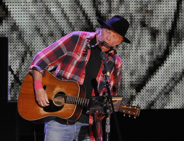 Neil Young, shown during the Farm Aid 2013 concert in New York on Sept. 21, will reunite with David Crosby, Stephen Stills and Graham Nash for the 27th Bridge School Benefit concert on Oct. 26-27 in Mountain View, Calif.