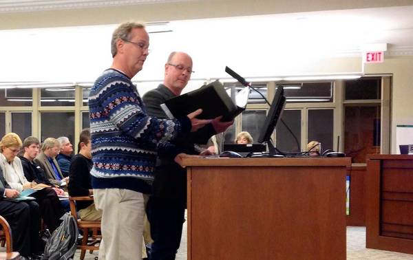 "Jeffrey (front) and David Hunt sing ""In St. Charles"" at a City Council committee meeting Monday night."