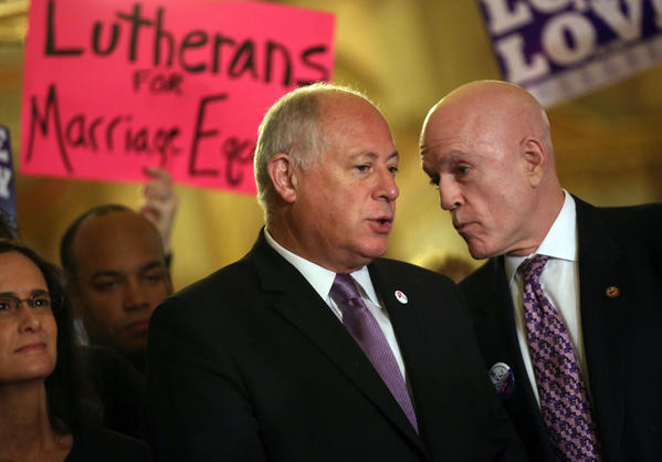 Gov. Pat Quinn confers with State Rep. Greg Harris during a rally at the Capitol in support of gay marriage.