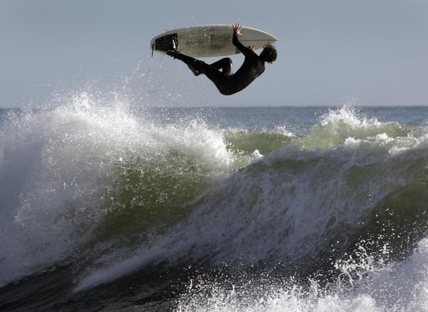 "A surfer hits the waves at the famous Rincon surfing point break at the Ventura and Santa Barbara County line. Forecasters have extended a warning for possible ""sneaker"" waves in the area until 10 p.m. Tuesday."