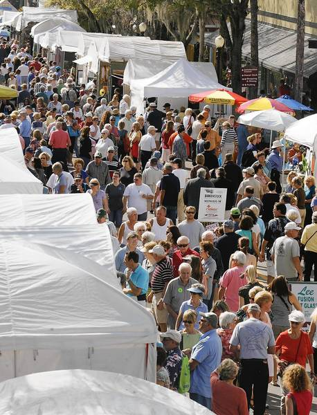 A crowd lines Donnelly Street during the 37th annual Mount Dora Arts Festival on Saturday, February 4, 2012.