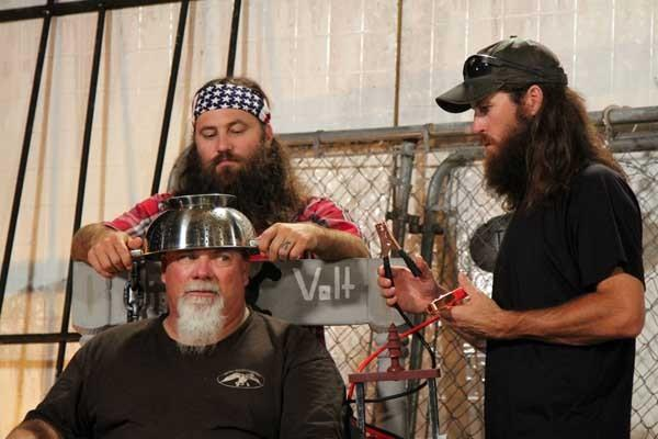 "It's Halloween on ""Duck Dynasty"" on A&E. Clockwise from front Godwin, Willie and Jase."