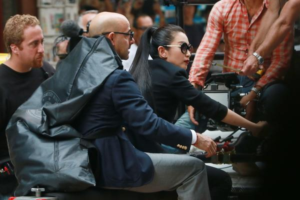 "Actress Li Bingbing and actor Stanley Tucci  filming ""Transfomers 4: Age of Extinction"" in Hong Kong."