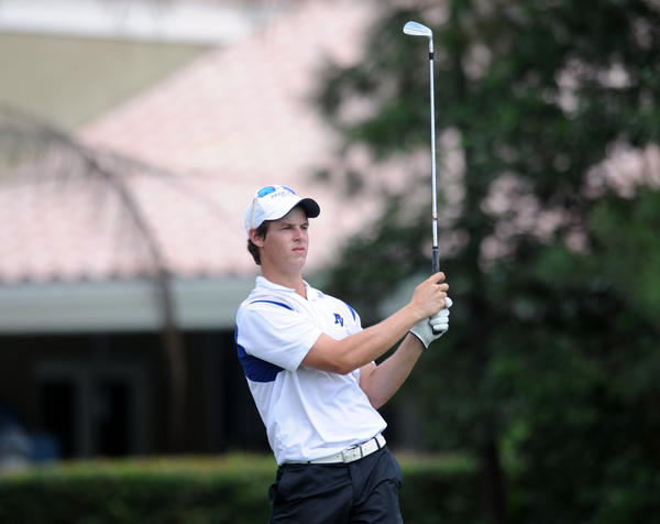 Park Vista junior Josh August follows his tee shot on the the 17th hole at the Jacaranda Golf Club's East course. August won medalist honors in the Region 3-2A boys tournament with a 3-under Par 68 on the Par 71 course on Tuesday and helped the Cobras win the team title.