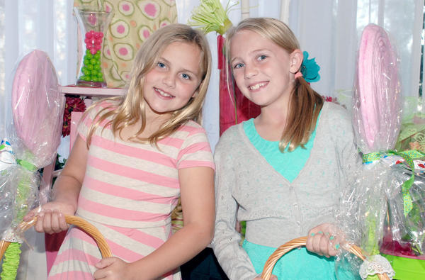 Representing the next generation of La Providencia Guild members, the Kelley sisters, Makala, 8, left, and Mckynzee, 10, assisted in making Saturday's event a sweet success.